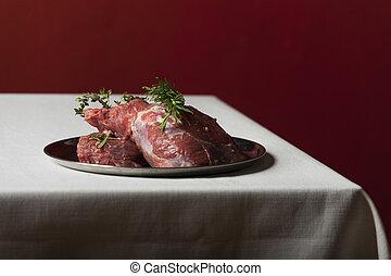 raw lamb meat on linen cloth