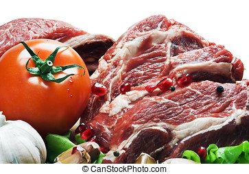 raw meat and fresh vegetables