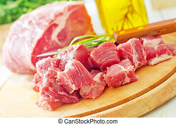 raw meat and knife on the wooden board