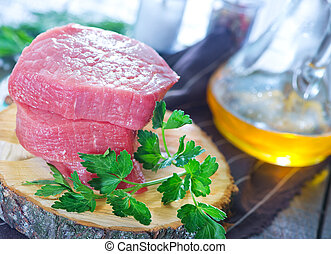 raw meat and parsley on the table