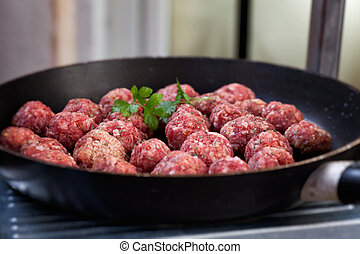 Raw meat balls in the pan. Beef meat balls