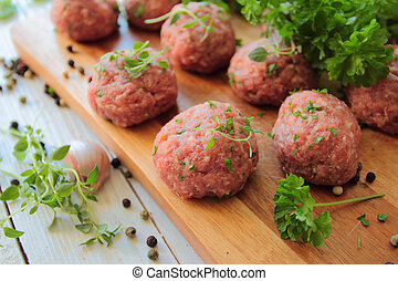 Raw meat balls with fresh parsley and herbs