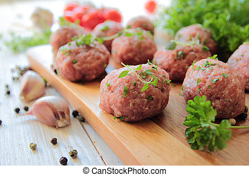 Raw meat balls with parsley and thyme herbs