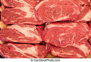 Raw meat. Chopped steaks from marbled beef with large layers...