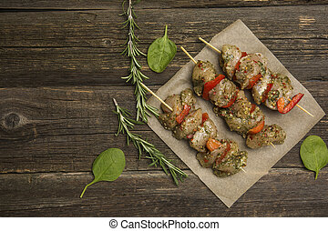Raw meat kebab on a wooden background