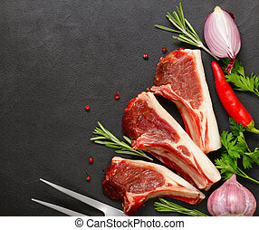 Raw meat, lamb ribs on a black background