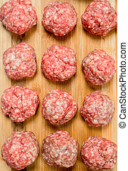 Raw meat meatballs on the Board .