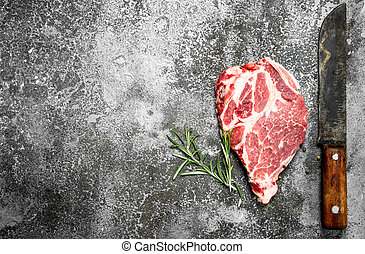 Raw meat of beef with rosemary.