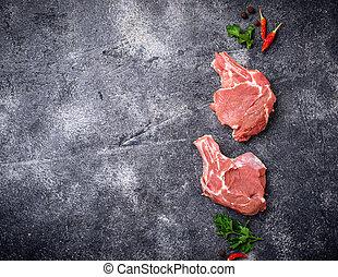 Raw meat on dark background