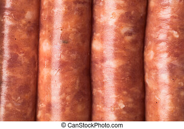 raw meat sausages, closeup view