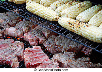 Raw meat with a corn on the grill