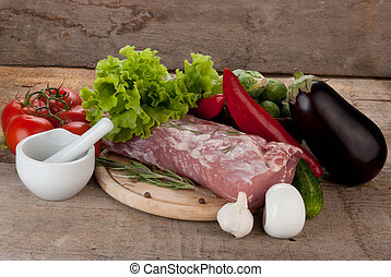 raw meat with vegetables  and porcelain mortar