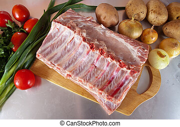 Raw meat with vegetables - Raw meat with vegetables on cook...