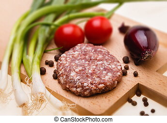 raw meatball on a chopping board and ingredients. horizontal. cl