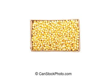 Raw millet in carton and on white background