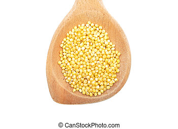 Raw millet on wooden spoon and white background