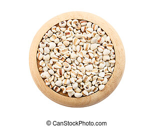 Raw millet rice in wooden dish on white background.