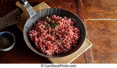 Raw minced meat with chives on pan - Raw minced meat with ...