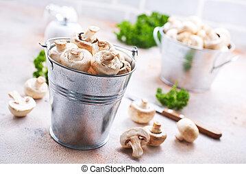 champignons - raw mushrooms in metal bucket, champignons in...