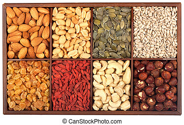 Healthy food organic nutrition. Wooden box full of raw seeds and nuts isolated on white background