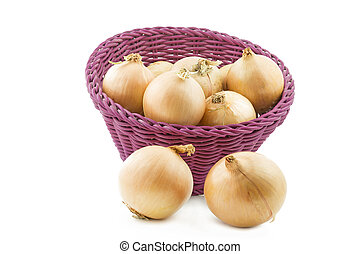 Raw onions in a basket, isolated on white