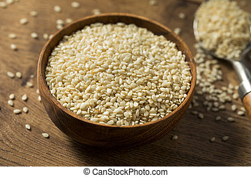 Raw Organic Dry White Sesame Seeds in a Bowl