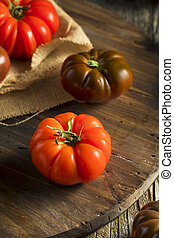Raw Organic Red and Brown Heirloom Tomatoes Fresh of the ...