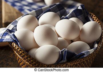 Raw Organic White Eggs in a Basket