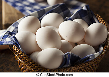 Raw Organic White Eggs in a Basket