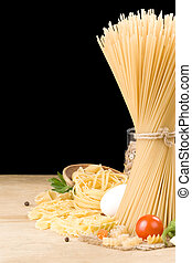 raw pasta and food ingredient isolated on black
