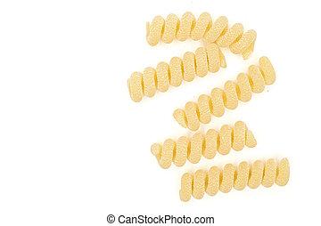Group of five whole fresh raw pasta fusilli bucati flatlay isolated on white background