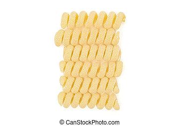 Group of six whole fresh raw pasta fusilli bucati flatlay isolated on white background