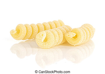 Group of three whole fresh raw pasta fusilli bucati pieces isolated on white background