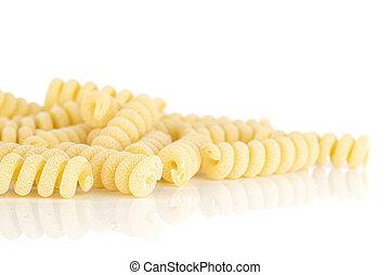 Lot of whole fresh raw pasta fusilli bucati heap isolated on white background