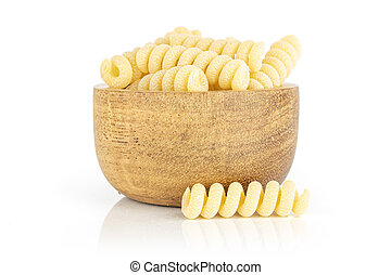 Lot of whole fresh raw pasta fusilli bucati in wooden bowl isolated on white background