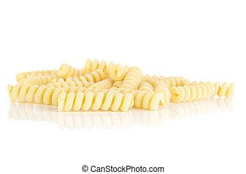 Lot of whole fresh raw pasta fusilli bucati isolated on white background