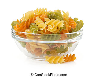 raw pasta in bowl on white
