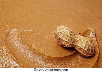 Raw peanut in swirl of creamy peanut butter.