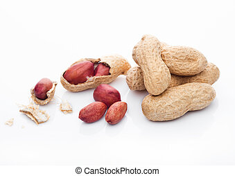 Raw peanuts with shell on white background