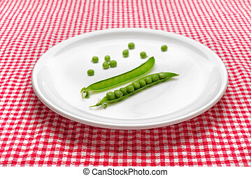 Raw peas on plate