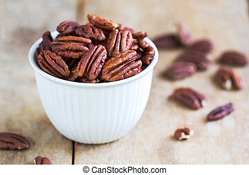Pecan - Raw Pecan in a white bowl on wooden board