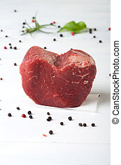 raw piece of beef loin on wood