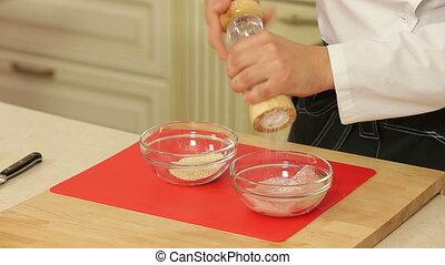 Raw piece of chicken breast in sesame breading - Raw piece...