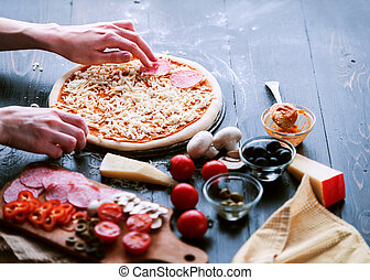Raw pizza ingredients