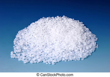 raw plastic - raw white plastic isolated at blue background