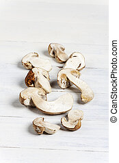 raw porcino mushrooms on wood