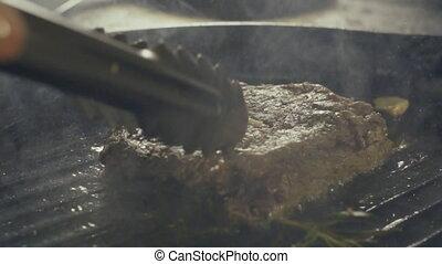 Raw pork chop in a frying pan