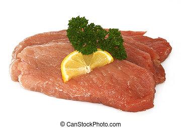 Fresh raw pork cutlet schnitzel on bright background