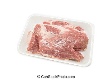 Raw pork in packaging tray