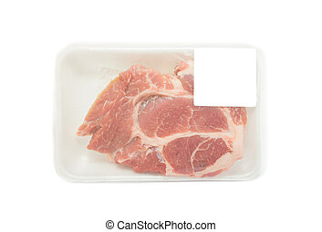 Raw pork in packaging tray with price tag